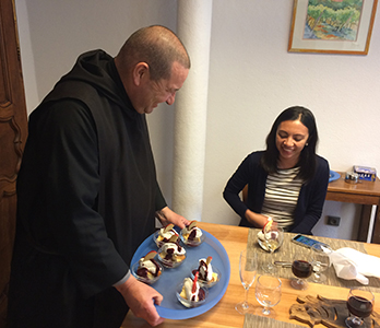 Father Hugues serves desert during the Ethics Seminar
