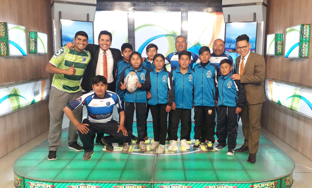 Jean Fontayne with a Santiago de Machaca team during a Bolivian TV interview