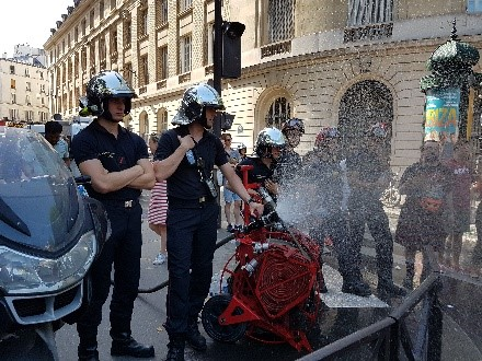 firemen douse the Paris Pride parade route