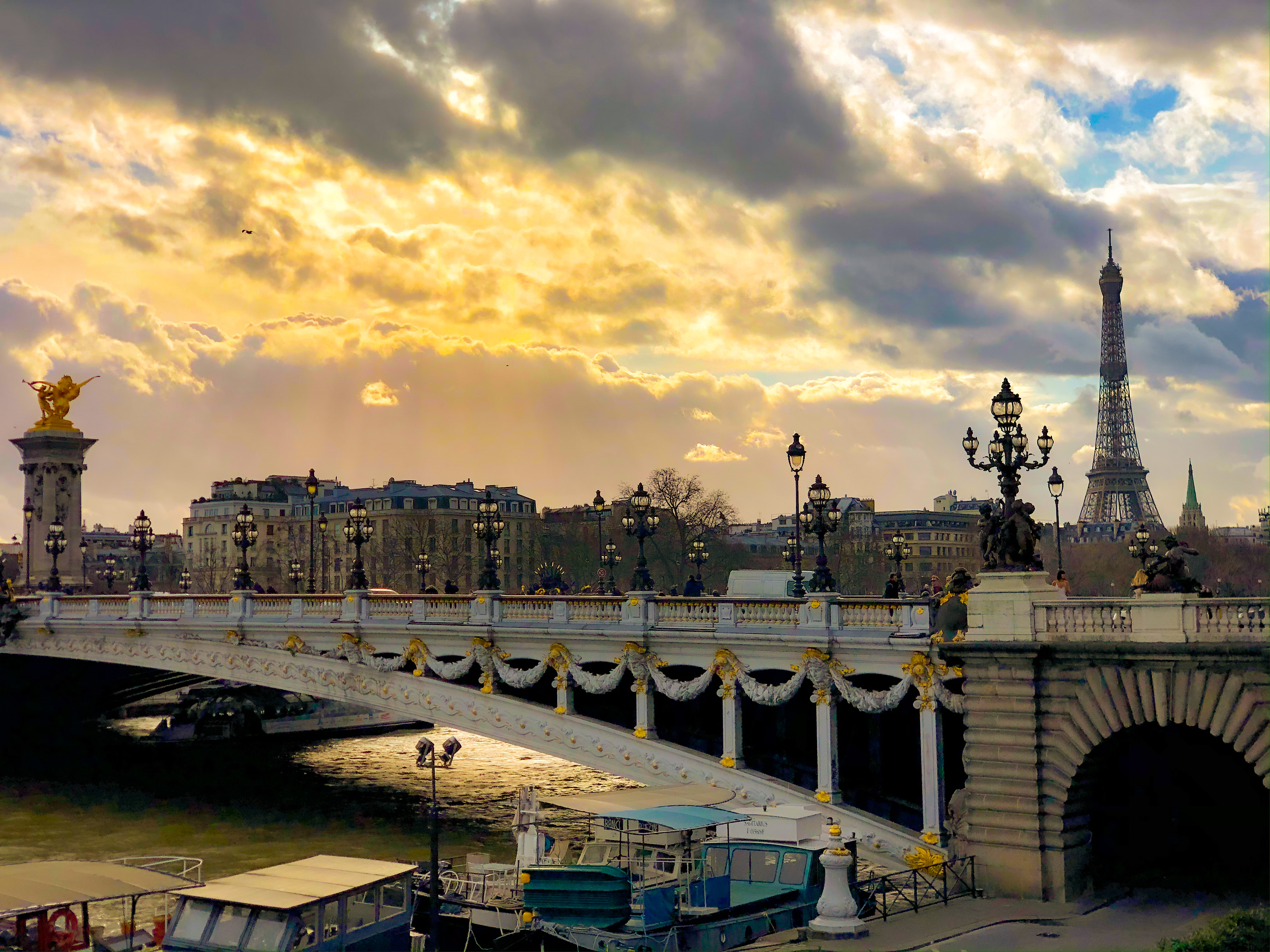 The Seine and a bridge at dusk, with the Eiffel towel in the background is part of what HEC Paris MBA students see in Europe