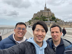 Chee Hao Lum (left) and friends at Mont-Saint-Michel
