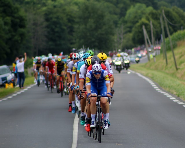 The best way to see the Tour de France in person is when the bikers are on a hill