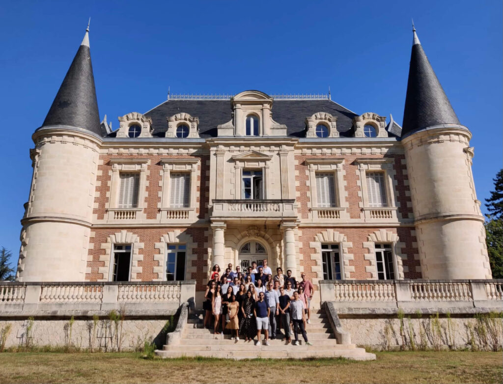 Students stand in front of the chateau at a Bordeaux winery